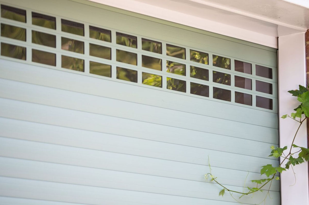 Close up of Green roller doors with Vision Slats at top